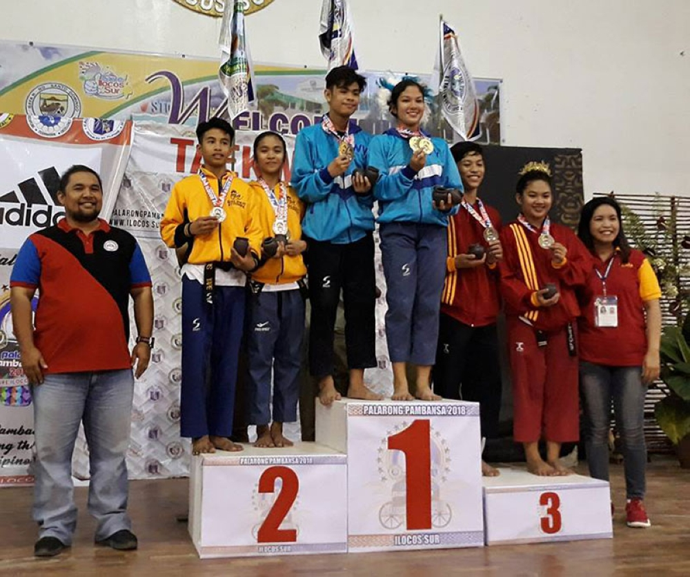 ILOCOS. The Yape siblings receive their taekwondo medals during the 2018 Palarong Pambansa. (Photo courtesy of Roderick Yape)