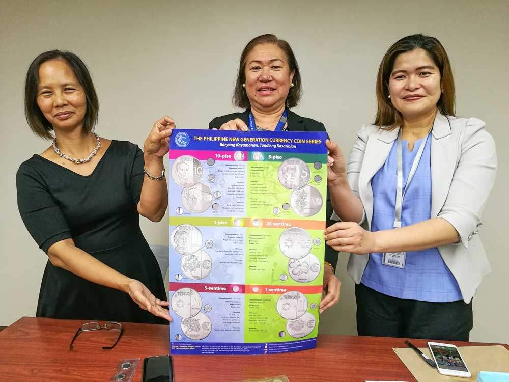 It's all in the details. (Left to right) BSP Visayas Regional Office Deputy Director Christine Tan, Regional Director Leonides Sumbi and Manager for Cash Anna Clara Oville hold up a poster showing the features of the New Generation Currency coin series. The central bank will be embarking on an information campaign in coordination with local government units to inform the public about the features of the newly released coins. (SunStar Foto/Arni Aclao)