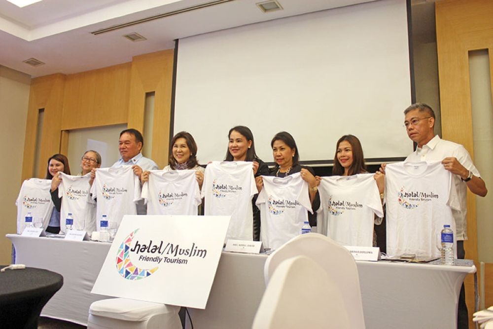 HALAL-FRIENDLY. The Department of Tourism, led by Secretary Wanda Teo (4th from left), unveiled on Wednesday, May 2, the official logo of the Halal/Muslim-Friendly Tourism program at the Marco Polo Hotel –Davao. (Andrew Ochoa Comoda)