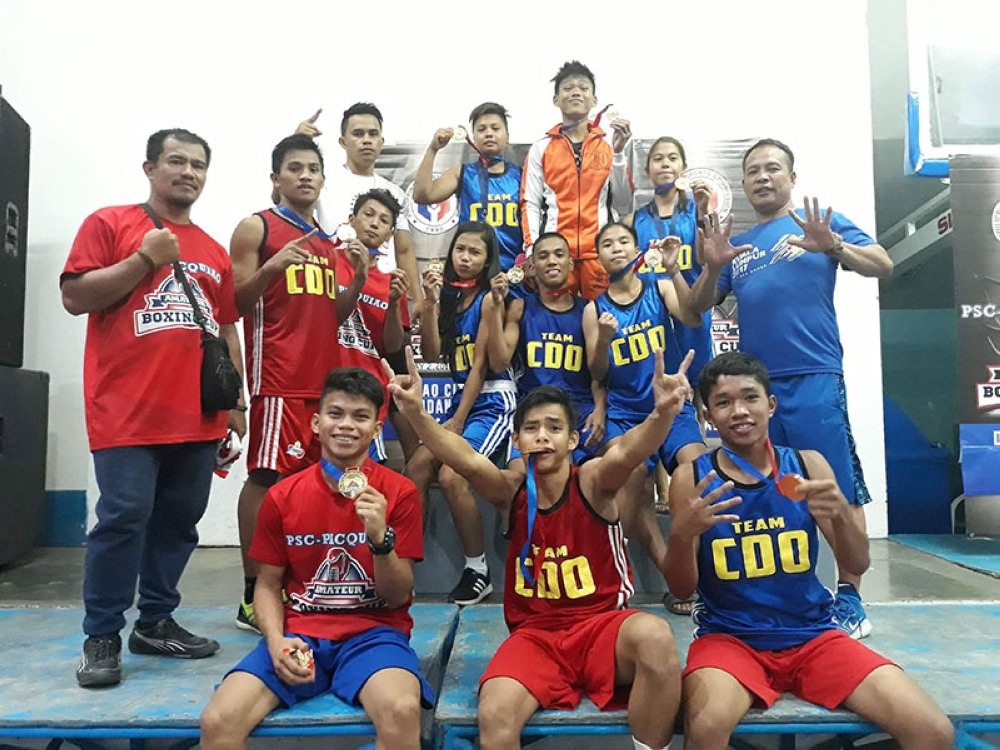 DAVAO. Members and coaches of the Cagayan de Oro City boxing team celebrate after dominating the PSC-Pacquiao Amateur Boxing Cup Mindanao Finals by harvesting a total of 10 gold medals and one silver at the Davao City Recreation Center Wednesday evening. (PSC-PSI)