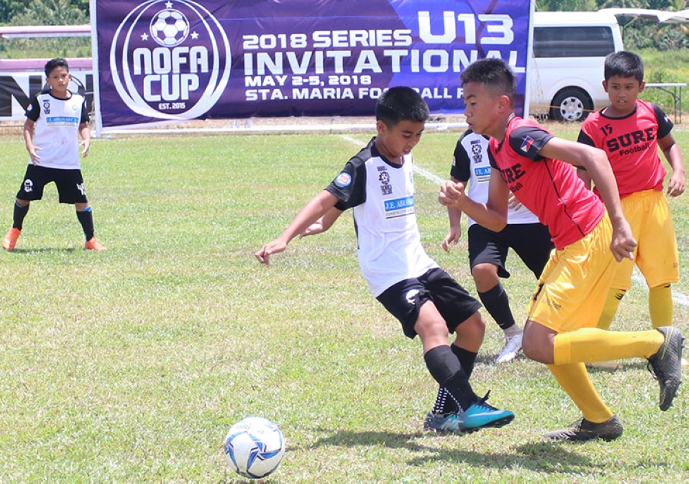 CAGAYAN DE ORO. Sam Salingay a reinforcement from Rosevale School (right) scores two goals and dished one assist in Golden Harvest's 3-2 win over Don Bosco Cebu in the first day of the Nofa Cup. (Jack Biantan)