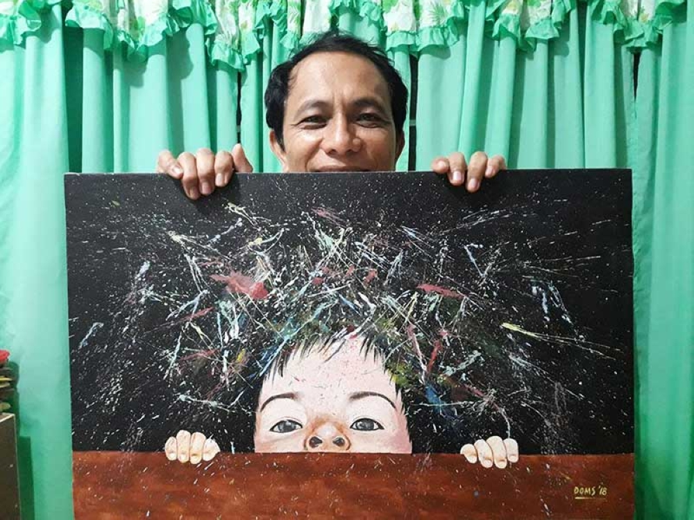 LEYTE. Tacloban artist and educator Doms Pagliawan shows his artwork. (Photo courtesy of Doms Pagliawan)
