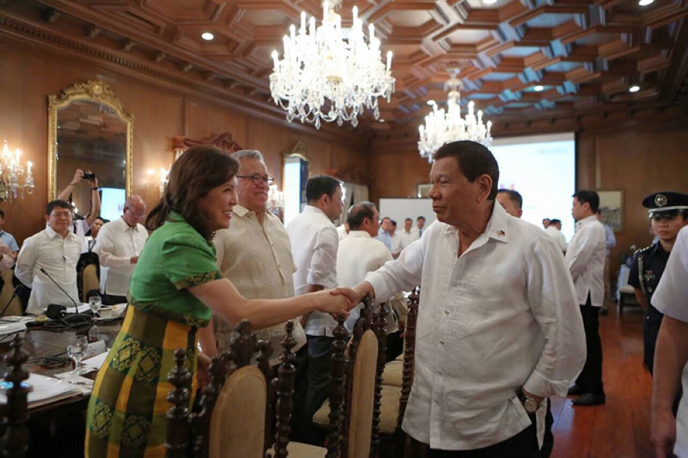 MANILA. A smiling Tourism Secretary Wanda Tulfo-Teo shakes the hands of President Rodrigo Duterte before the Cabinet meeting in this photo taken on May 7, 2018 by Special Assistant to the President Christopher Go. (Contributed Photo)