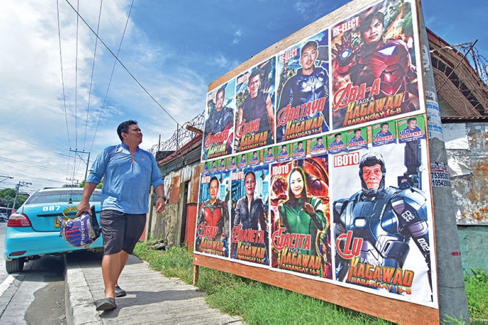 DAVAO. Candidates running for post in Barangay 16-B in Davao City cropped their faces into the superhero suits to catch the attention of passers-by. The Commission on Elections however cautioned against such as the candidates can be sued for copyright infringement. (Macky Lim)