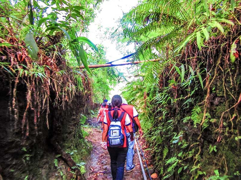 Walking towards the Upper Caliban-Imbang Watershed for a tree planting activity