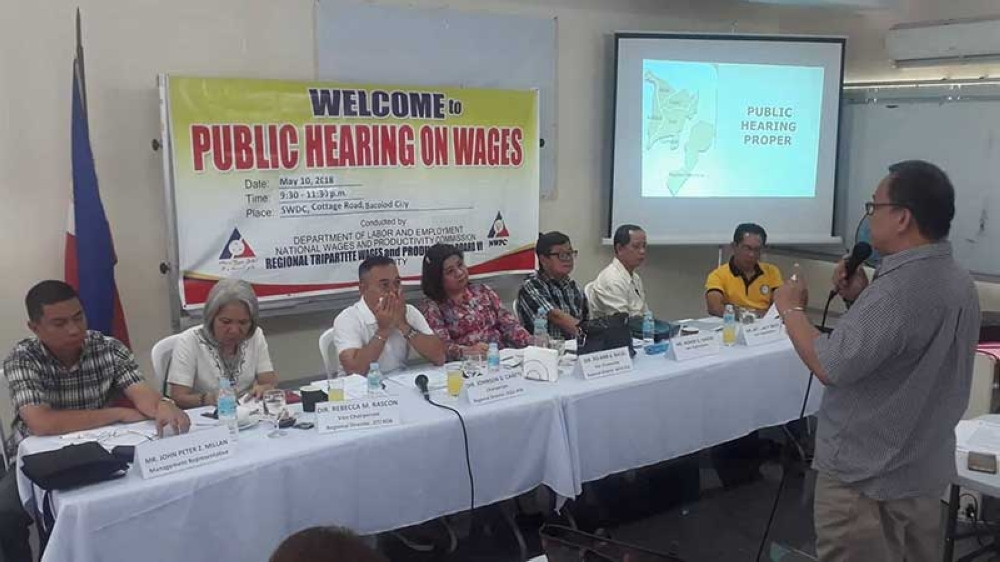 Confederation of Sugar Producers manager Herman Santos (standing) presents their opposition to the proposed P130 to P150 daily wage increase before the members of the Regional Tripartite Wages and Productivity Board Region 6 led by chairman Atty. Johnson Cañete (seated, 3rd from left) during the last public hearing held at Dole Negros Occidental Provincial Office in Bacolod City yesterday, May 10. (Erwin P. Nicavera Photo)