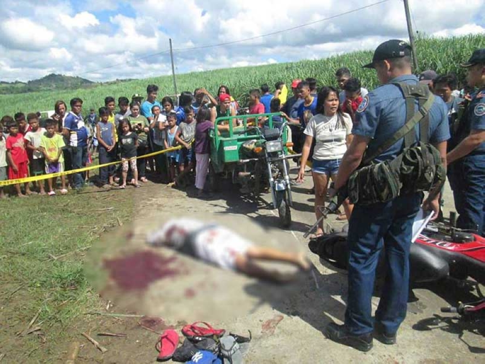 Police cordon the area where 66-year-old Lusan Ledama, an alleged military asset, was killed by suspected rebels at Barangay San Isidro in Toboso, Negros Occidental Thursday, May 10. (Contributed Photo/Toboso Municipal Police Station)