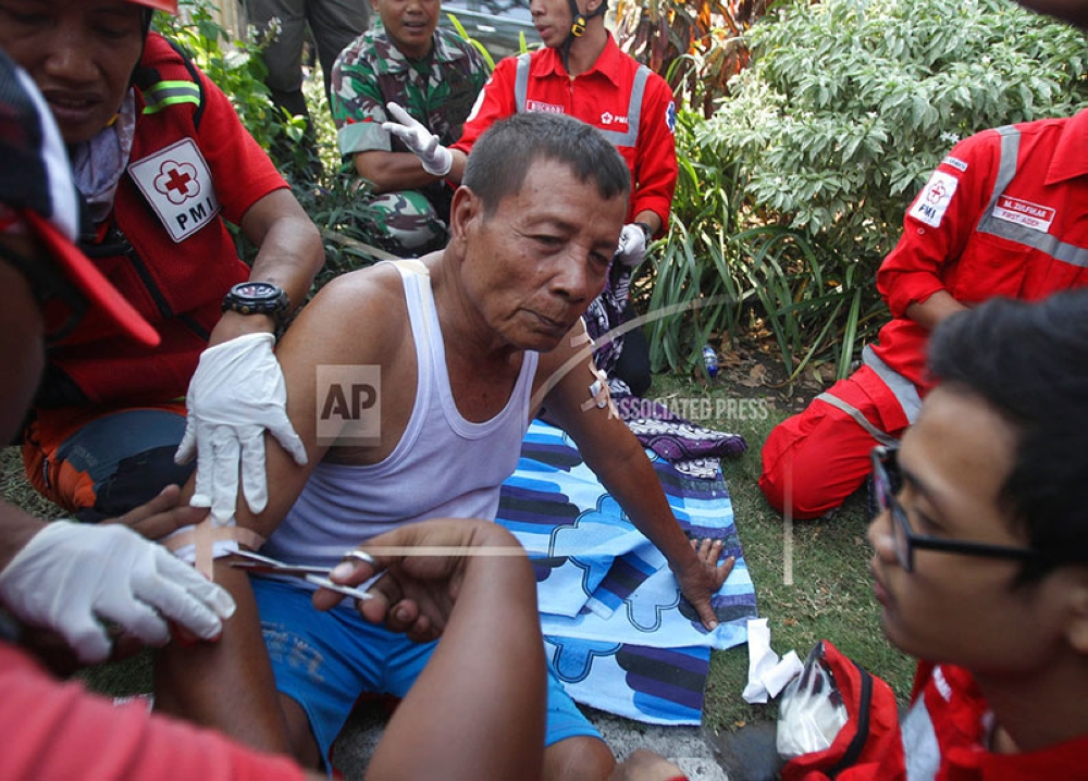 INDONESIA. Paramedics tend to a man injured in a church explosion in Surabaya, East Java, Indonesia, Sunday, May 13, 2018. Almost simultaneous attacks including one by a suicide bomber disguised as a churchgoer targeted churches in Indonesia's second largest city of Surabaya early Sunday, killing a number of people and wounding dozens, police said. (AP)