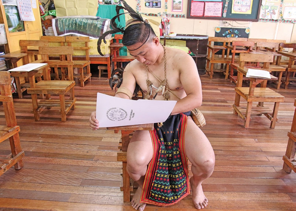 BAGUIO. Educator Vladimir Cayabas dressed in his Cordilleran attire cast his vote at the Lucban Elementary School to show his patriotism during the Barangay and SK Elections. (Milo Brioso)