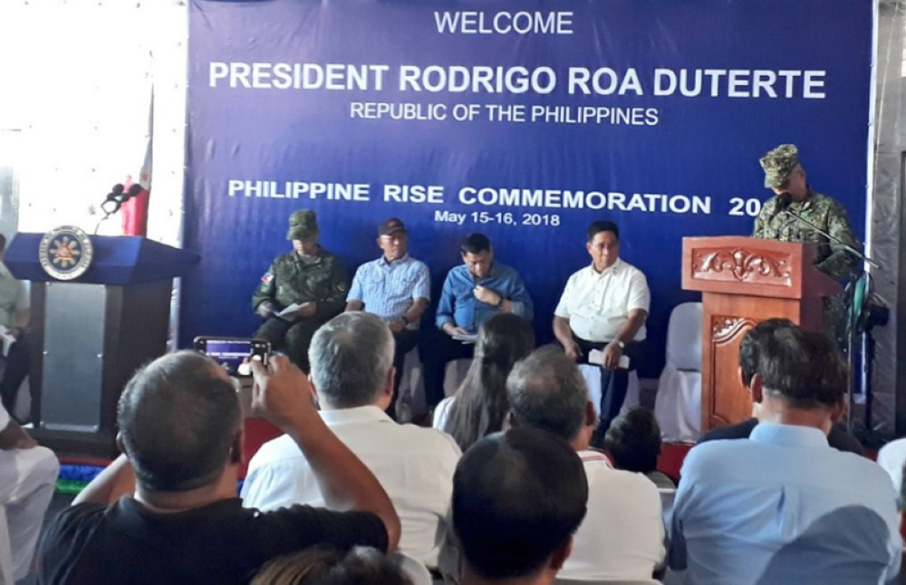 MANILA. President Rodrigo Duterte (sitting, 2nd from right), waits for his turn to give a speech on board BRP Davao del Sur on May 15, 2018. (Ruth Abbey Gita/SunStar Philippines)