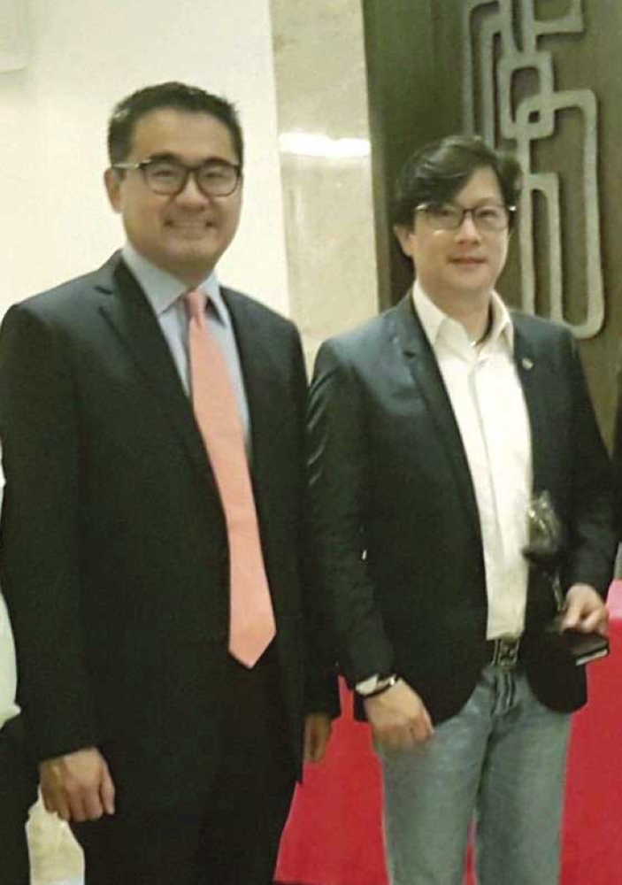 Honorary consul. The first honorary consul of the Republic of Latvia to Cebu Frederick Go (left) with Presidential Assistant for the Visayas Michael Dino. At right is Consul General Robert Lim Joseph of the Republic of Latvia.
