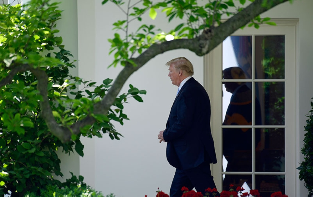 USA. President Donald Trump walks out of the Oval Office and toward Marine One on the South Lawn of the White House in Washington, Tuesday, May 15, 2018, as he heads to Walter Reed National Medical Center to visit with first lady Melania Trump who is recovering from a kidney procedure. (AP)
