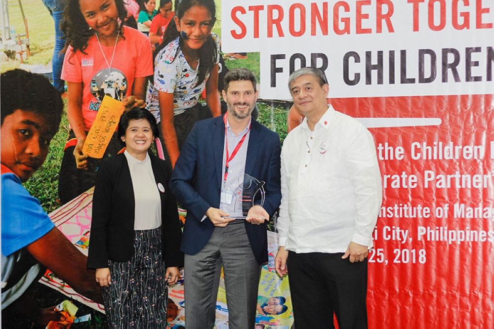 MANILA. Prudence Foundation Executive Director Marc Fancy (center) accepting the award of Partner of the Year from (L-R) Save the Children Director for Fundraising and Marketing Celine Santillan and CEO Atty. Albert Muyot. (Contributed photo)