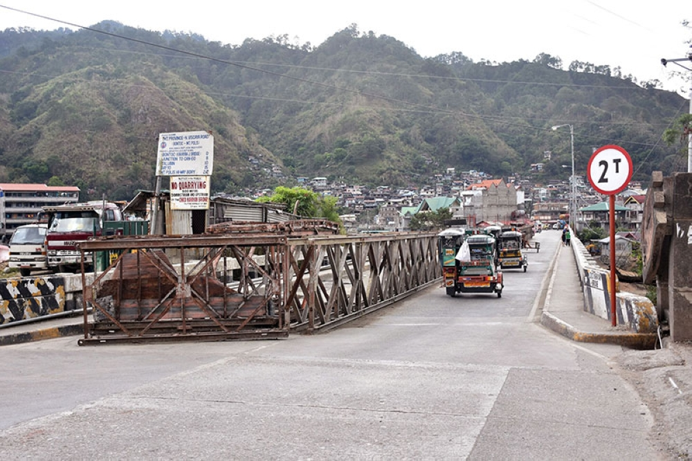BAGUIO. Tricycles take turn in passing through the Samoki Bridge in Bontoc, Mountain Province. The bridge is still up for renovation after being damaged by a typhoon in 2016. (Redjie Melvic Cawis)