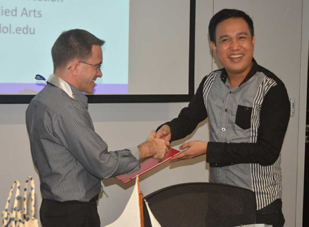 Our professor Walter Yudelmo (right) with Dr. Jerimiah Morris of Mahidol University International College