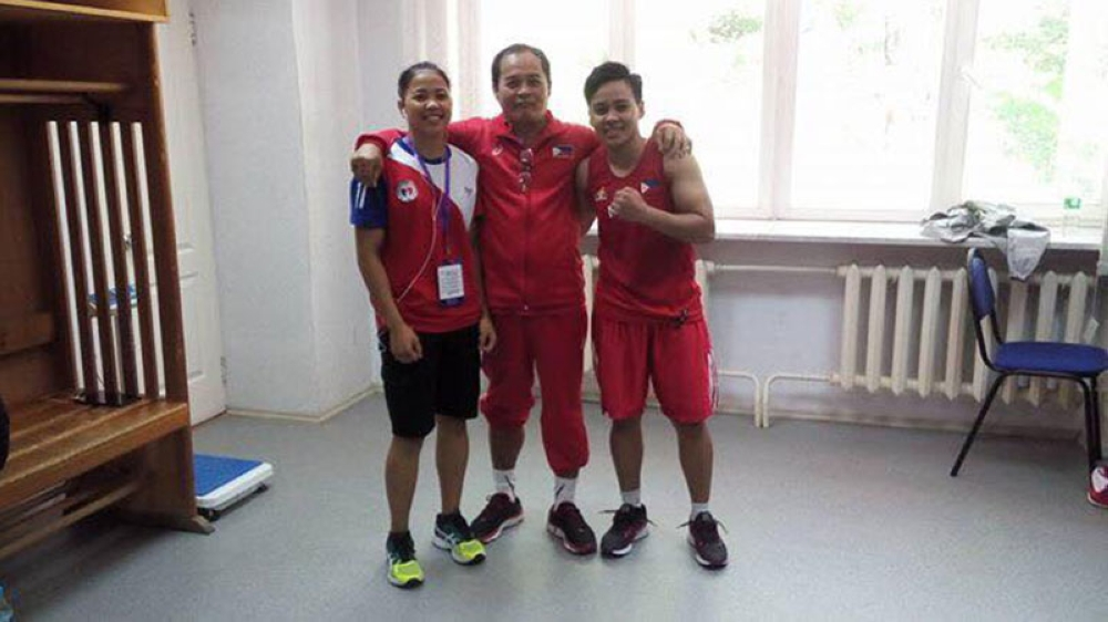 OFF TO SEMIS. From left, Aira Cordero Villegas, national women's boxing coach Nolito Velasco and former Davao City standout Nesthy Alcayde Petecio pose after the two boxers defeated their quarterfinals opponents in the Korotkov International Tournament yesterday in Russia. Villegas and Petecio are assued of bronzes. (Nolito Velasco Facebook)