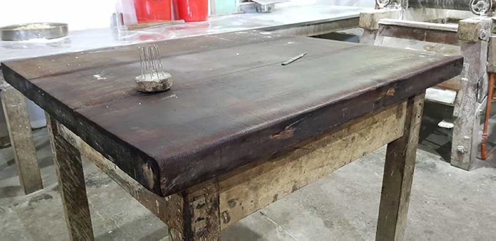 A wooden table just for making hojaldres.