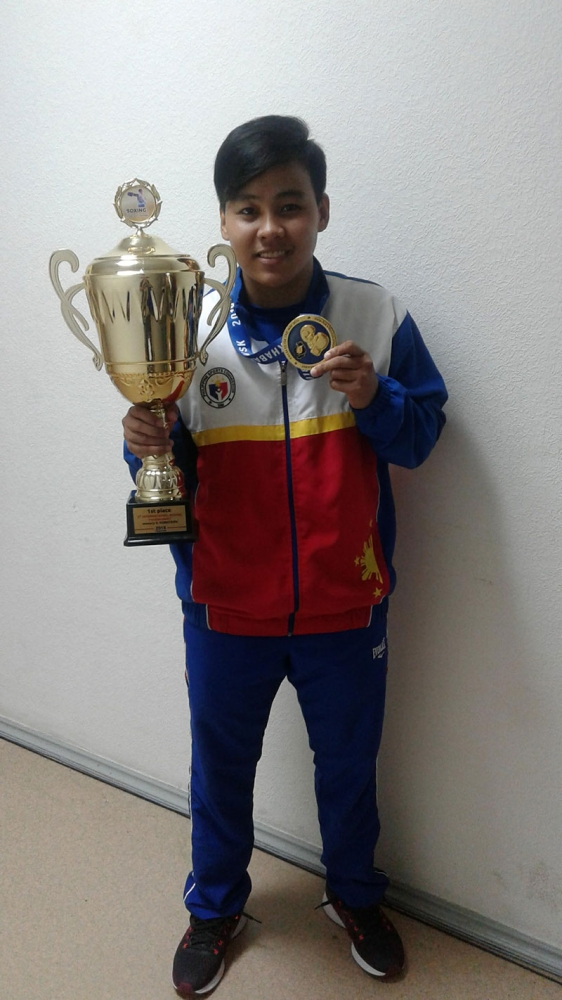 THREE'S A CHARM. Nesthy Alcayde Petecio, who started boxing in Davao City, shows the giant trophy and her gold medal after dominating the women's 57 kilograms division of the 10th International Boxing Tournament in Honor of Konstantin Korotkov in Russia yesterday. It's her third gold in an international tournament this year. (Contributed Photo)