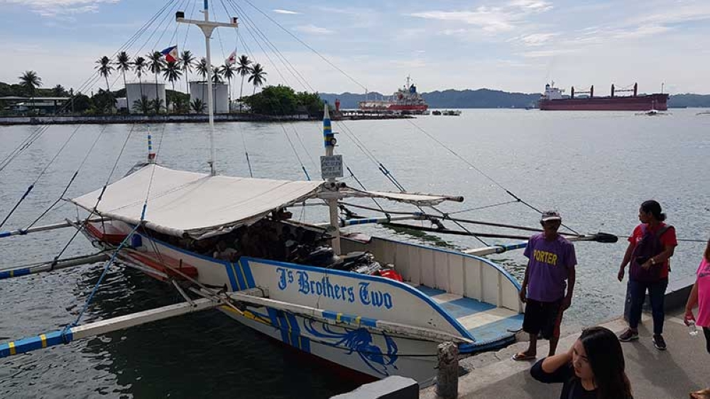 The motorized boat going to and from Guimaras