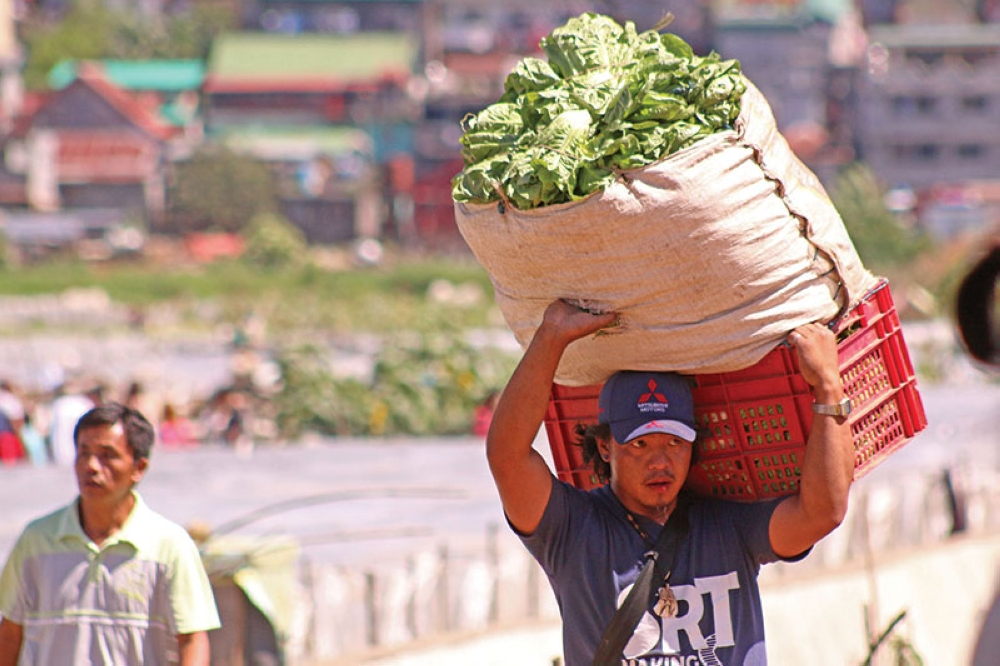 BAGUIO. Farmers directly bring their produce to the local market in La Trinidad, Benguet. Aside from the service industry, agriculture, hunting and forestry remain the biggest employer in Cordillera with 42.1 percent share in October 2017. (Milo Brioso)