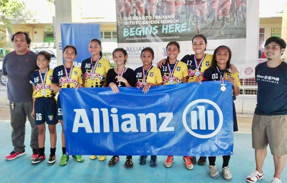 OFF TO DAVAO. Bulua Lady Strikers Girls 14U team with coach Jun Actub (left) are set to compete in the Mindanao elimination of the Allianz National Youth Futsal Invitational in Davao. (Contributed photo)