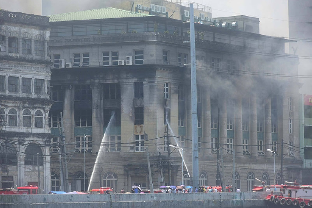 MANILA. Smoke billows out of the Juan Luna Building, which houses the National Archives of the Philippines. Fire that originated from the Land Management Bureau on Monday, May 28, 2018, spread to Juan Luna Building and two other adjacent structures. (Alfonso Padilla/SunStar Philippines)