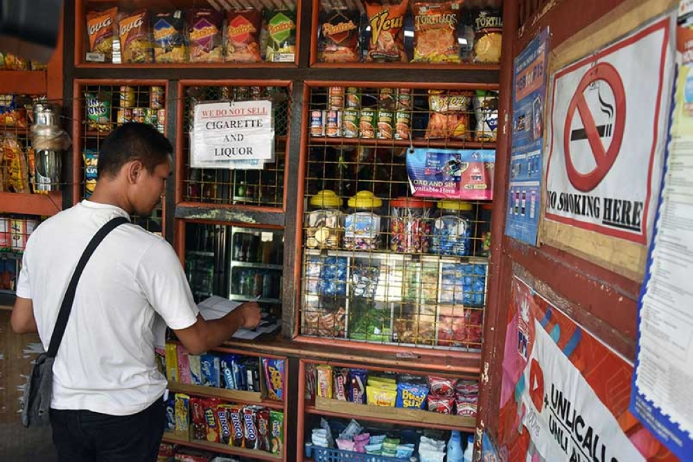 BAGUIO. The Smoke Free Baguio Task Force led by Dr. Donnabel Tubera of the Baguio Health Department inspect various business establishments including sari-sari stores in the City of Baguio to ensure that cigarettes are not being sold near schools as mandated by the anti-smoking ordinance of the city. (Redjie Melvic Cawis)