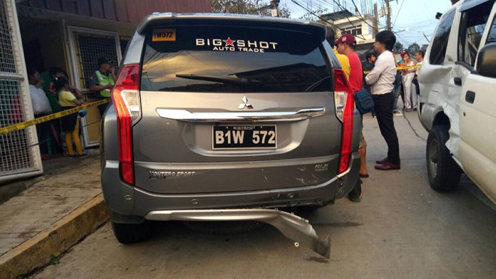 BAGUIO. The suspects' vehicle got stuck after it rammed a police vehicle that was prepositioned to block their escape on Monday, May 28, 2018. (Photo courtesy of Cordillera Police)