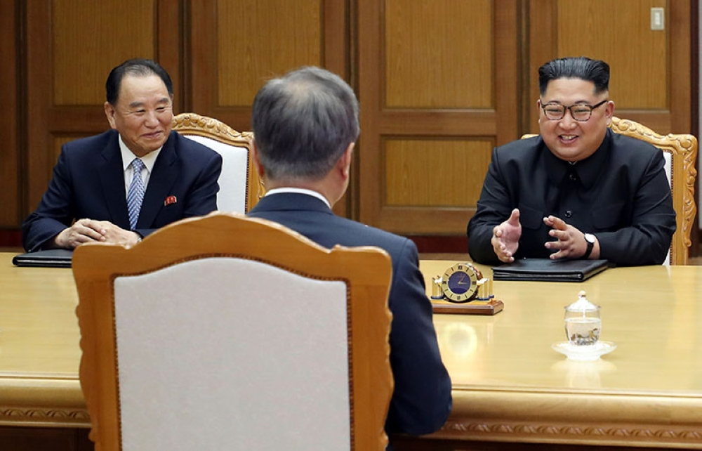KOREA. In this May 26, 2018 file photo provided by South Korea Presidential Blue House, North Korean leader Kim Jong Un (right) talks with South Korean President Moon Jae-in (center) during a meeting at the northern side of Panmunjom in North Korea. At left is Kim Yong Chol, a former military intelligence chief who is now a vice chairman of the North Korean ruling party's Central Committee tasked with inter-Korean relations. (AP)