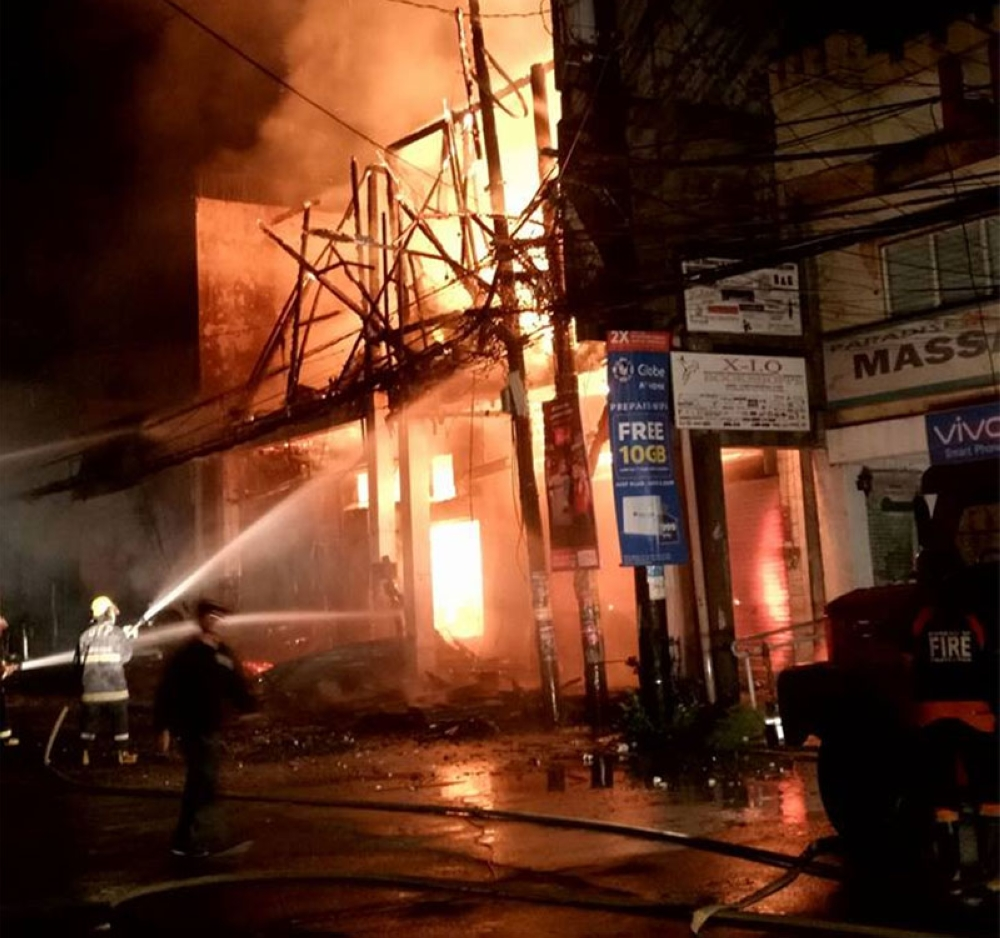 DUMAGUETE. The fire engulfed the Times Mercantile and Parlem's Collections of RTWs buildings in Dumaguete City on Wednesday, May 30, 2018. (Photo courtesy of Jun Luther Quillano Leyes)