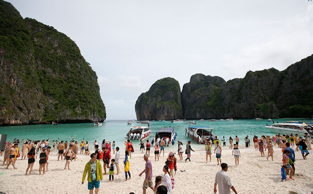 THAILAND. Tourists walk the beach of Maya Bay, Phi Phi leh island in Krabi province, Thailand, Thursday, May 31, 2018. (AP)