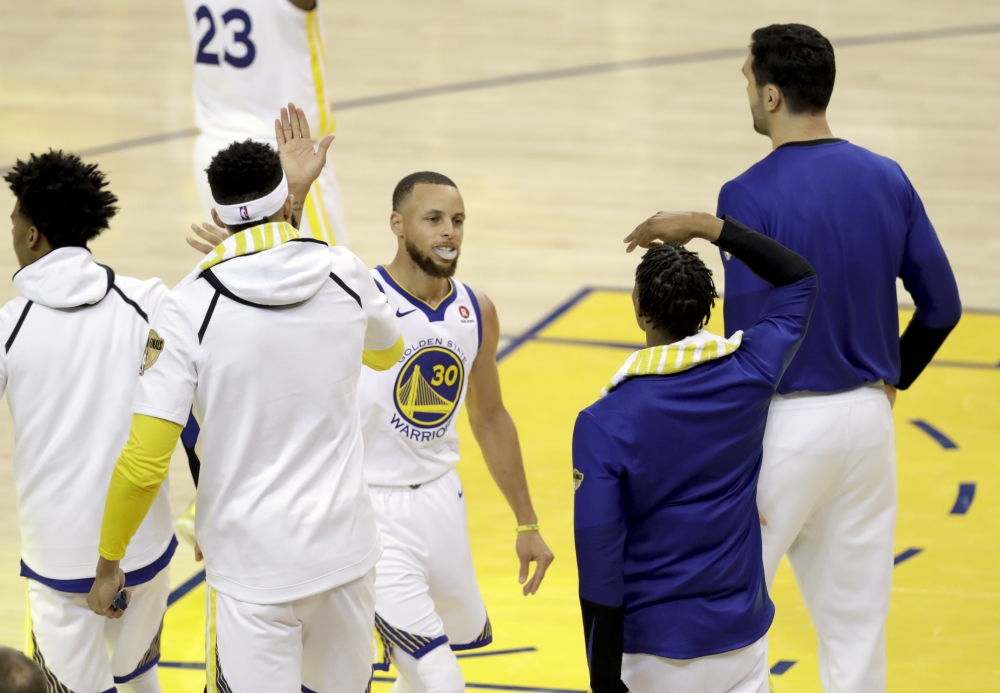 9455c787ef8 Golden State Warriors guard Stephen Curry (30) celebrates with teammates  during the second half of Game 1 of basketball s NBA Finals between the  Warriors ...