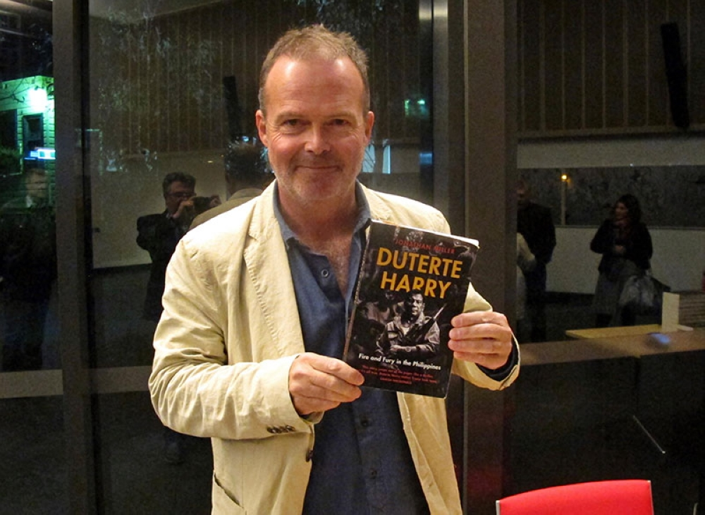 AUSTRALIA. Author Jonathan Miller displays his biography of Rodrigo Duterte at a book-signing event on Thursday, May 31, 2018, at the Australian National University in Canberra, Australia. Miller says the maverick Philippine president is gravitating toward China partly because of a personal animosity toward the United States and its criticism of his human rights record. (AP Photo)