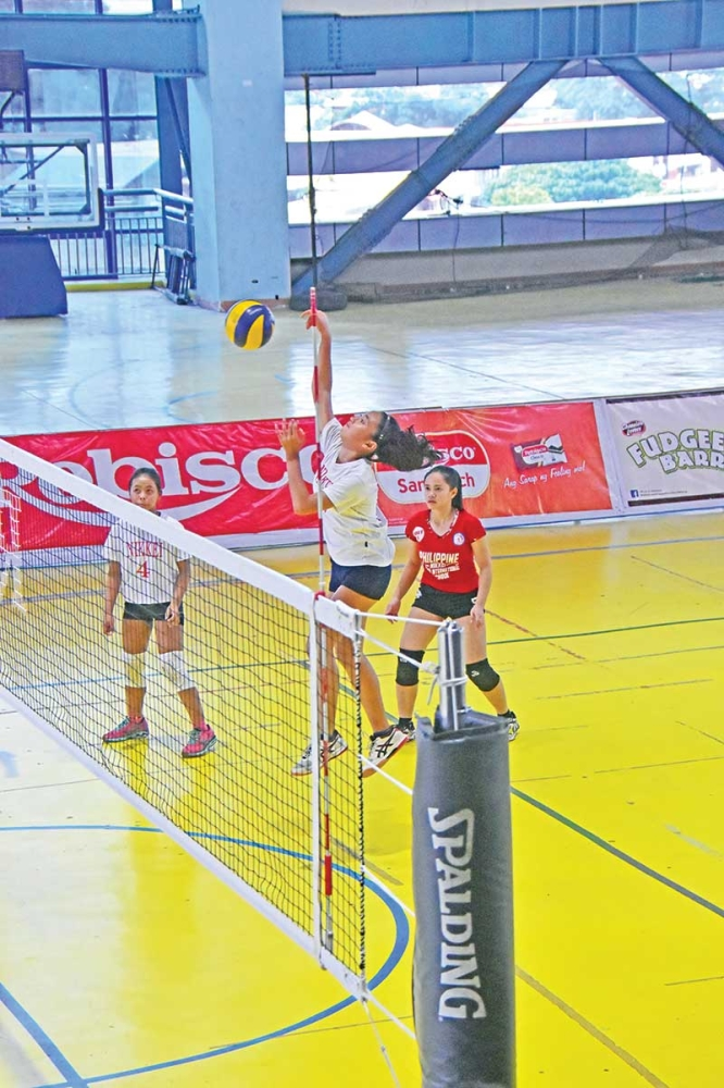 DAVAO. A Philippine Nikkei Jin Kai International High School (PNJKIS) spiker scores against Mati City National High School in yesterday's opener of the 1st Rebisco Volleyball League (RVL) girls under 18 Regional Finals held at the seventh floor of Martin Hall, Ateneo de Davao University (Addu) Jacinto campus. (Macky Lim)