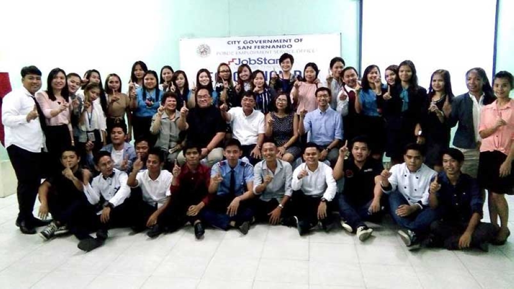 PAMPANGA. Mayor Edwin Santiago, Department of Labor and Employment Pampanga Chief Arlene Tolentino and Public Employment Services Office Manager Donny Sayre join the 98 Fernandino youth who finished the 10-day life skills training under the JobStart program of the City of San Fernando. (Contributed photo)