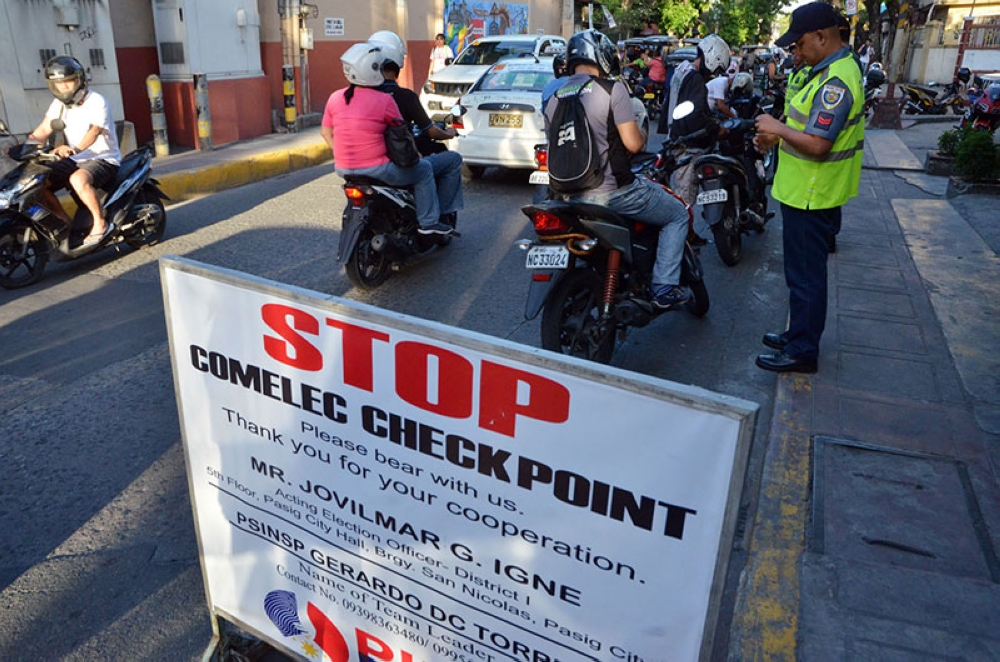 MANILA. In this photo taken before the May 14, 2018 Barangay and SK elections, motorcycle riders are flagged down for inspection at a checkpoint in Pasig City, Metro Manila. (Alfonso Padilla/SunStar Philippines)