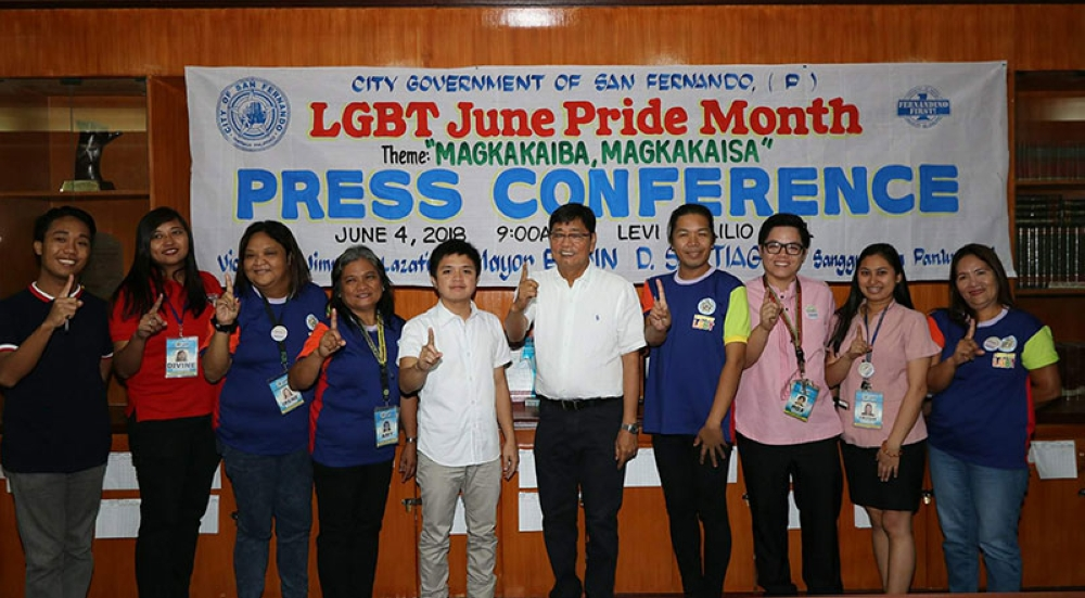 PAMPANGA. City of San Fernando Mayor Edwin Santiago and Siwala president Randy Ocampo together with members of the LGBT community flash the Fernandino First sign during yesterday's LGBT June Pride Month launch and press conference at Levi Panlilio Hall. (Chris Navarro)