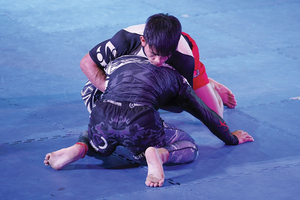 BAGUIO. Dave Banguigui of Fight Corps MMA and Danny Kingad of Team Lakay La Trinidad try to outwit each other during the gold medal match in the absolute division of the 30th Team Lakay Grapplers Cup during the weekend. (Contributed photo)