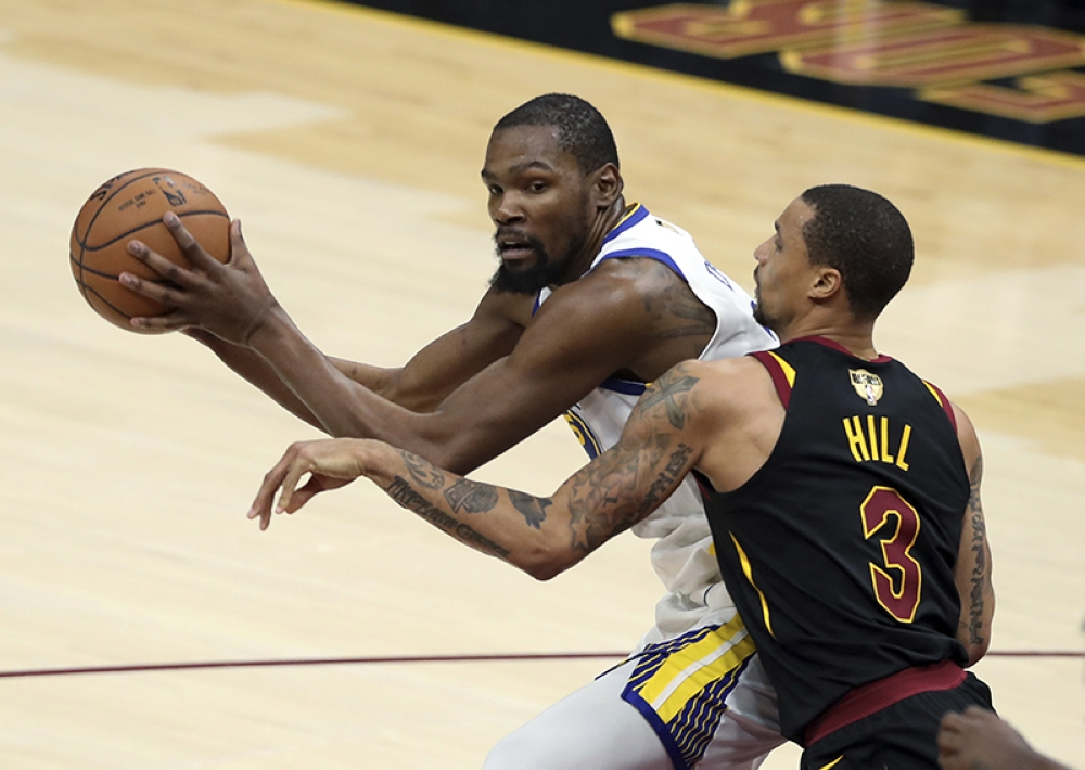 014af64aedd5 Golden State Warriors  Kevin Durant is defended by Cleveland Cavaliers   George Hill during the second half of Game 3 of basketball s NBA Finals