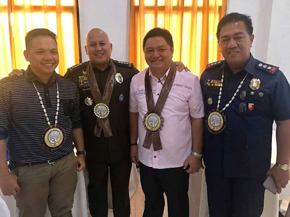 LEYTE. Bureau of Corrections Director General Ronald dela Rosa poses with Leyte Schools Division Superintendent Ronelo Al Firmo, Assistant Schools Division Superintendent Edgar Tenasas, and Leyte PNP Provincial Director Norberto Tuazon as he thanked the education officials for helping the rehabilitation program of their agency through the opening of the first senior high school program to at least 63 inmates at Leyte Regional Prison in Abuyog, Leyte, on June 8, 2018. (Ronald O. Reyes)