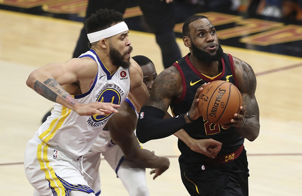 CLEVELAND. Cleveland Cavaliers' LeBron James goes to the basket against Golden State Warriors' JaVale McGee during the first half of Game 4 of basketball's NBA Finals, Friday, June 8, 2018, in Cleveland. (AP)