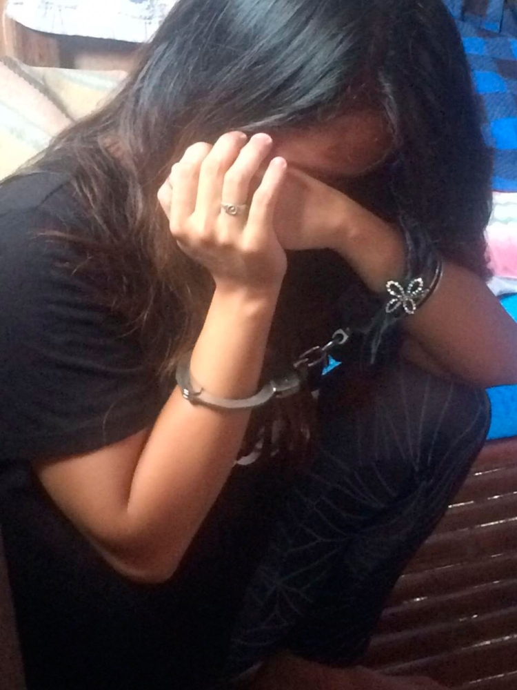 Arrested. Donna (not her real name) is taken into custody after she offered to sexually abuse two minors in exchange for money from online predators. (Contributed Foto/International Justice Mission)
