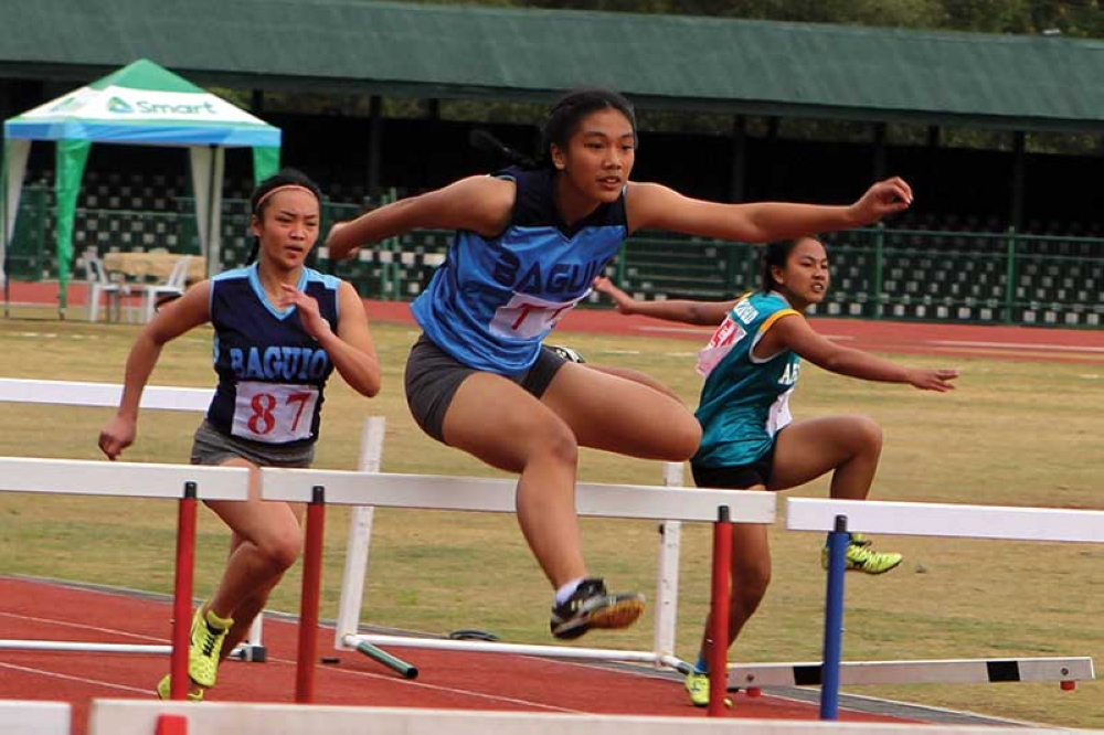 ISABELA. Baguio City's Thryxen Alfonzo leaps past her opponent during a recent regional meet. Alfonzo earned a silver medal in the recently concluded 2018 Ayala Philippine Athletics Championships held in Ilagan, Isabela. (Roderick Osis)