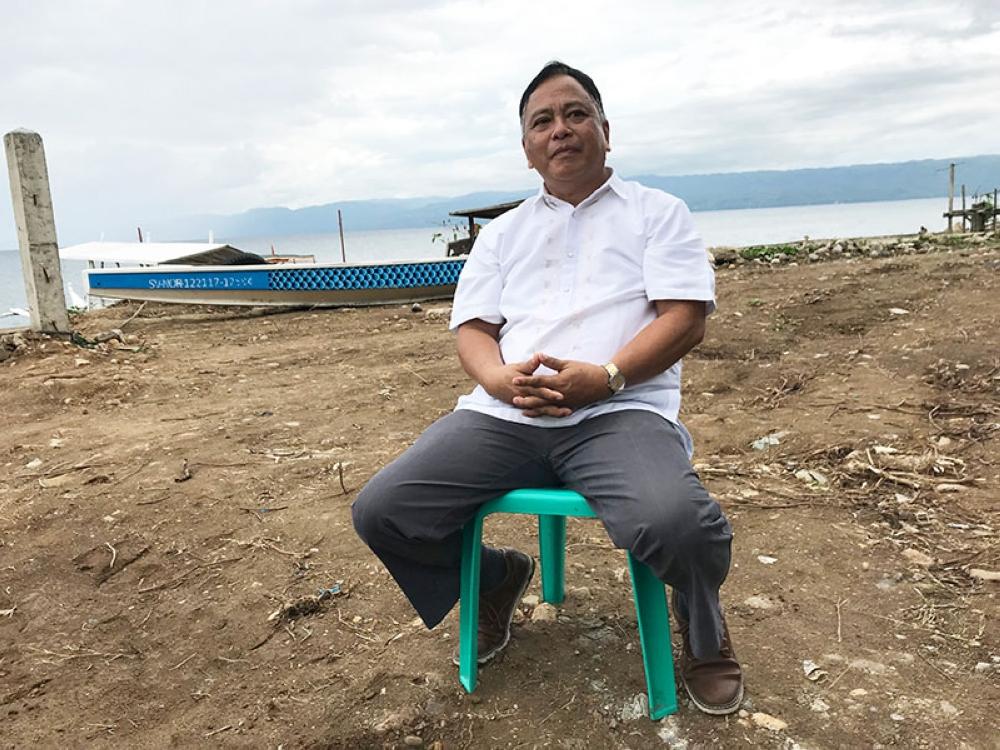 ENFORCER. Amlan town Vice Mayor Bentham dela Cruz is among those strictly enforcing fisheries laws on Tanon Strait. (Stella A. Estremera)