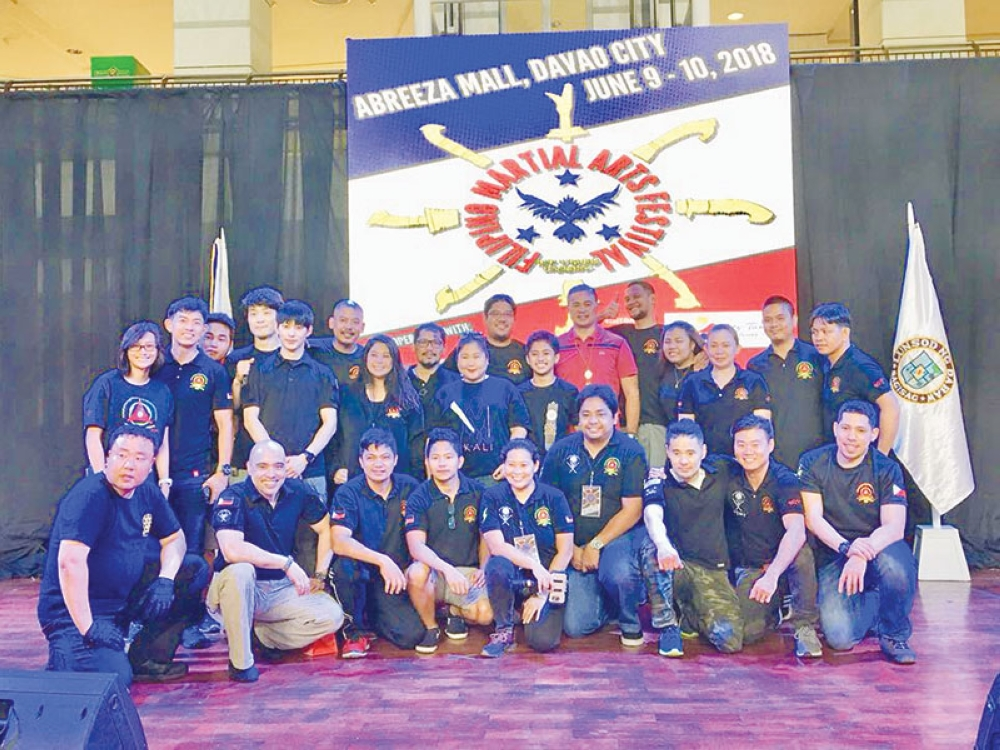 DAVAO. Olympian and Makati Representative Monsour Del Rosario poses with some of the participants of the Filipino Martial Arts (FMA) Festival held over the weekend at the Abreeza Ayala Malls Activity Area. (Photo from Monsour del Rosario Facebook)