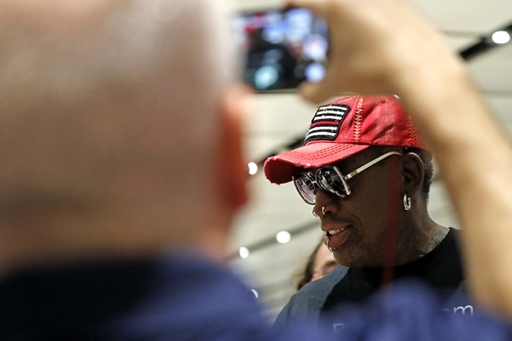 SINGAPORE. Former NBA basketball player Dennis Rodman arrives at Singapore's Changi Airport on Tuesday, June 12, 2018. (AP)