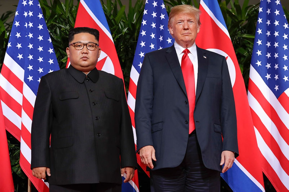 SINGAPORE. United States President Donald Trump stands with North Korea leader Kim Jong Un for a photograph at the Capella resort on Sentosa Island Tuesday, June 12, 2018 in Singapore. (AP)