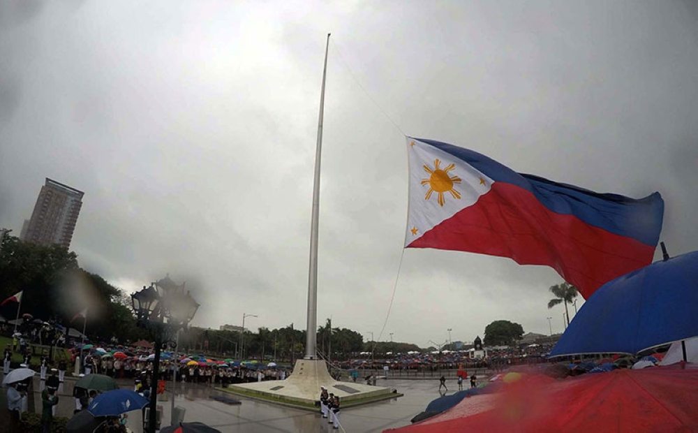MANILA. The Philippine flag is raised during the 120th Independence Day ceremonies at the Rizal Park in Manila on Tuesday, June 12, 2018. (Alfonso Padilla/SunStar Philippines)