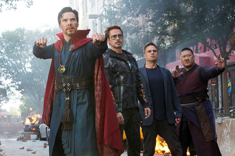 This image released by Marvel Studios shows, from left, Benedict Cumberbatch, Robert Downey Jr., Mark Ruffalo and Benedict Wong in a scene from