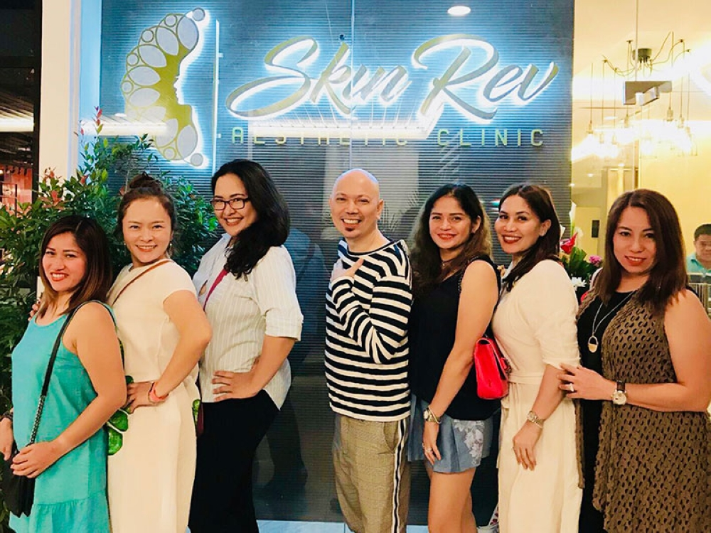 Posing by the Skin Rev logo during their opening and blessing with Joy Co, Koeun Lee, the writer, Doc Mendez, Weena Adelante, Arrissa Navarro, and Noemi Orbegoso. (Contributed photo)